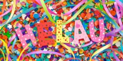 "Photo: Colorful lettering ""HELAU"" on confetti and paper streamers; Copyright: PantherMedia/Barbara Neveu"