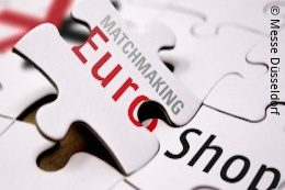 White puzzle pieces with the EuroShop logo and lettering on them