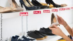 Photo: Woman searching for some shoes in a local shop; copyright: panthermedia.net/Andriy Popov