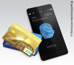 Foto: Smartphone with a fingerprint on it. Next to is are several credit cards; Copyright: panthermedia.net/chesky_w