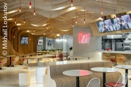 A modern fast food restaurant with wavy wood panels at the ceiling; copyright: Mikhail Loskutov