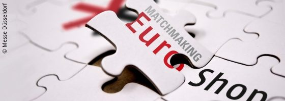 White puzzle pieces with inscription and EuroShop logo; copyright: Messe Düsseldorf