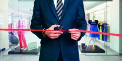 Image: Man cuts a ribbon; Copyright: Imperial Logistics International