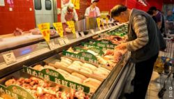 Photo: meat counter with customers